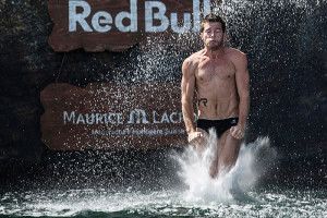 Steven Lobue of the USA dives from the 28 metre platform during the fourth stop of the Red Bull Cliff Diving World Series, Kragero, Norway on July 12th 2014. // Romina Amato/Red Bull Cliff Diving // P-20140712-00210 // Usage for editorial use only // Please go to www.redbullcontentpool.com for further information. //