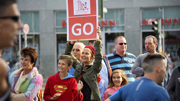 former-drr-member-anja-schwerin-holding-up-a-sign-at-the-10k-mark