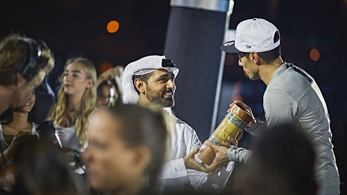 Dubai Tourism CEO H.E. Issam Kazim presents the trophy to Jonatan Paredes of Mexico during the awards ceremony of the ninth and final stop of the Red Bull Cliff Diving World Series in Dubai, UAE on October 28, 2016.