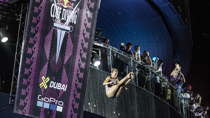 Rhiannan Iffland of Australia dives from the 20.5 metre platform on the Dubai Marina Pier 7 building during the ninth and final stop of the Red Bull Cliff Diving World Series in Dubai, UAE on October 28, 2016.