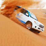 Dune bashing in desert